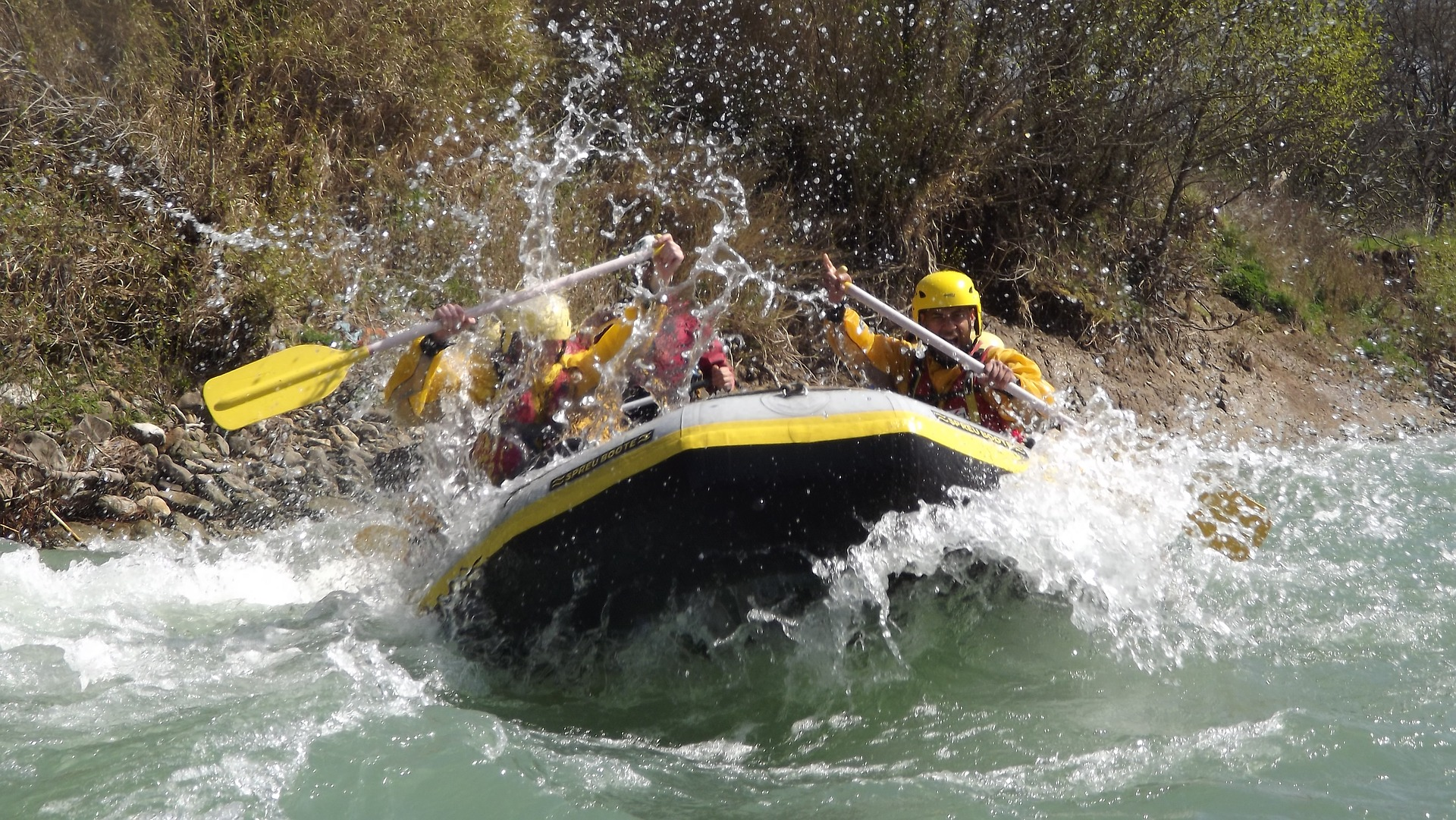 People white water rafting in an inflatable boat